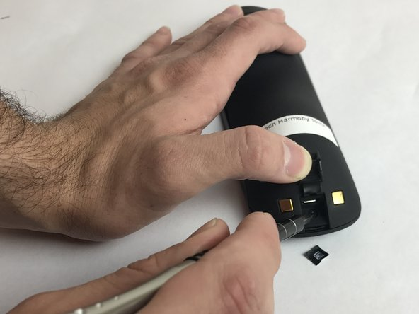 Open the latch that accesses the charging port