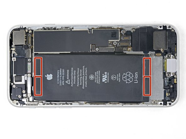 The iPhone's battery is secured by four pieces of stretch-release adhesive—two at the top, and two at the bottom.