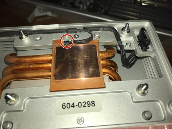 Using a lint free cloth (such as a coffee filter) and high percentage isopropyl alcohol, clean the bottom of the heatpad on the heat sink. It should have a bright sheen to it once you have finished.