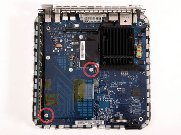 Remove the two silver Phillips screws from the corners of the wireless interface board.