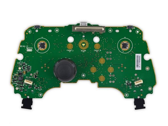 The motherboard is a fiberglass plane home to a smattering of circuit elements. We do our due diligence and identify: