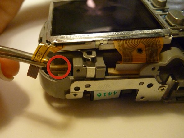 Flip Camera to the bottom side as shown.