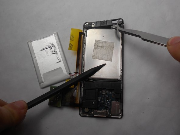 Use a nylon spudger or tweezers to remove the plastic protective plate at the top of device.