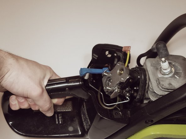 Pull and hold the throttle trigger to expose the throttle linkage attachment point (on the trigger)