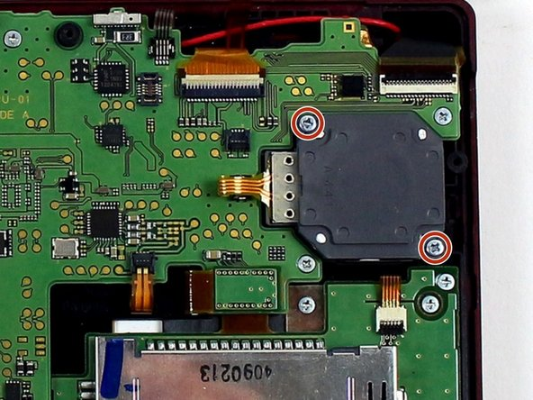 Using a JIS #000 screwdriver, remove the two 8 mm screws securing the circle pad.