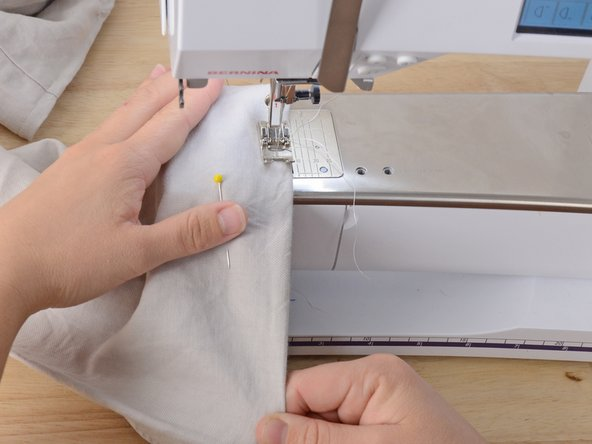 Gently depress the foot pedal and begin sewing.