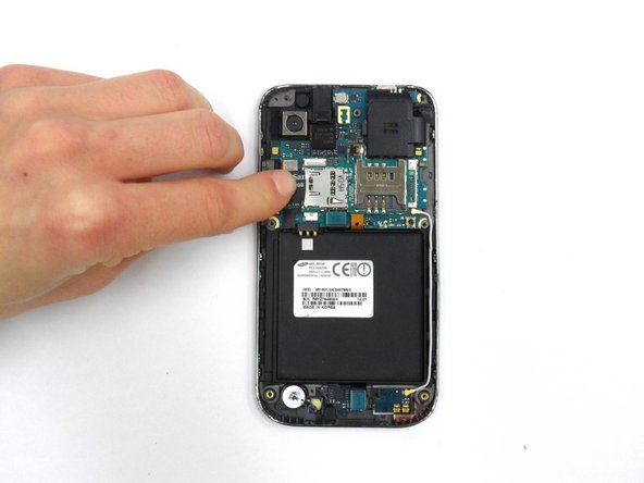 Slide the SD card out of its slot.