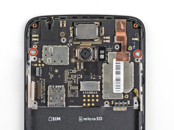 Remove the two 3.1 mm long Phillips screws securing the motherboard.
