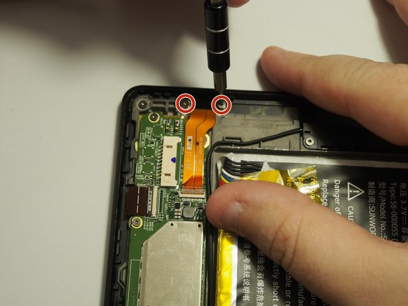After locating the USB port at the top of the device, remove the (2) 3mm T4 Torx screws.