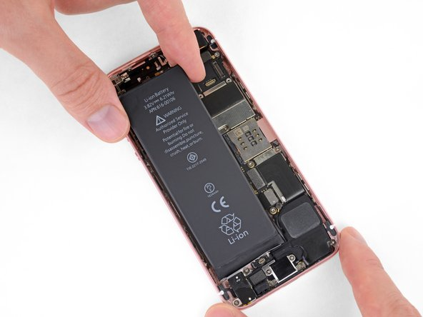Before installing new adhesive strips, temporarily connect your new battery and check its alignment in the iPhone.