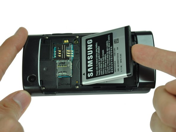 Place your finger on the bottom of the battery and lift to remove.