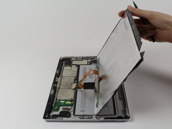 Flip the display over so that parts underneath it are easily accessible.