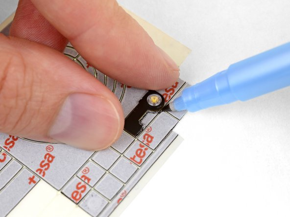 Use a small rectangle or an uncut part of the card to cut out odd shapes for small components.