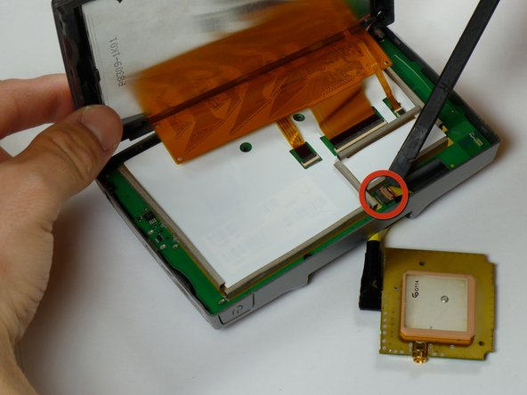 Use a spudger to disconnect the yellow antenna wire from the ZIF connector by opening the brown latch holding the wire in place.