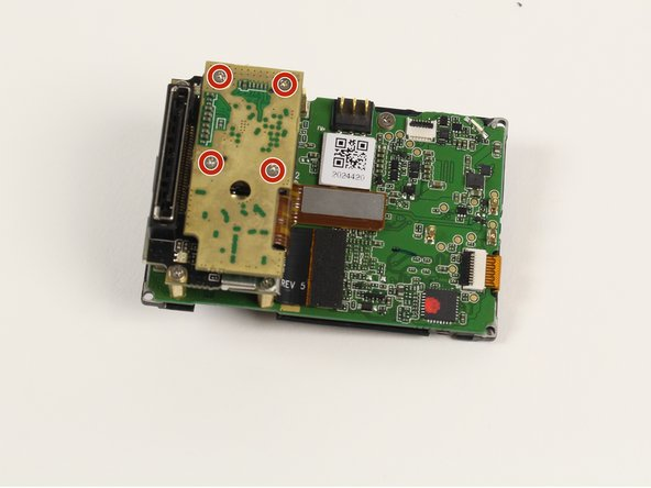 Remove the four 4mm PH00 screws attaching the image sensor to the motherboard with your screwdriver.