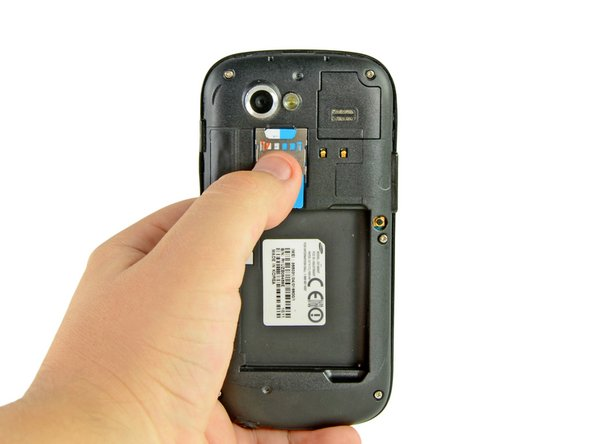 Use your thumb to slide the SIM card downwards from the SIM card slot.