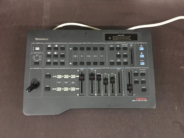 This is a Digital AV Mixer (Model WJ-AVE5) and we'll be covering the steps required to remove the top-board and controls.