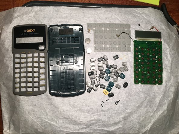 Boom! That was cool. Those little keycaps are individual and so cute! There's nothing really user replaceable except for the batteries, but you can still dry it off if it got wet. Simply snap everything back together to reassemble! I'd give this a 9/10 for repairability. There's only screws but you can't replace the screen.
