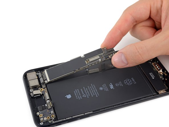 Lift the logic board from the bottom edges and slide it toward the bottom of the iPhone to remove it.