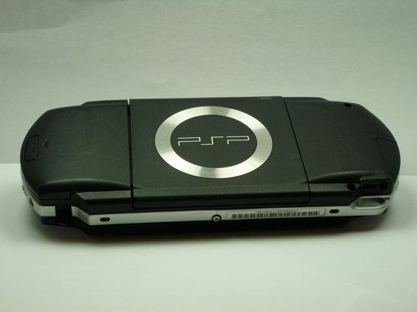 Turn the PSP over so its back is facing you.