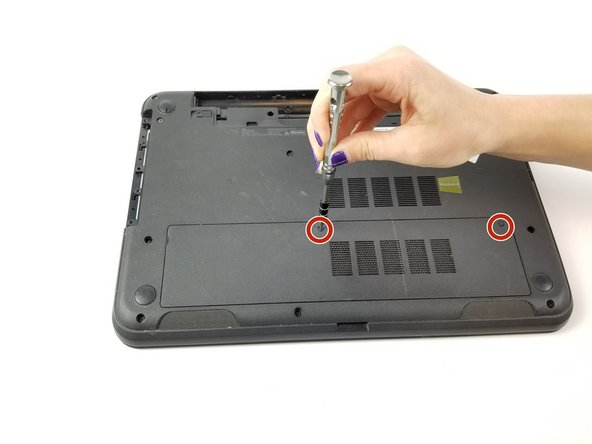 Loosen the two screws on the access panel using the PH1 head screwdriver.