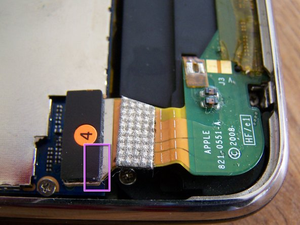 The dock connector water sensor sticker has turned pink too, indicating liquid flooding of this end of the phone.