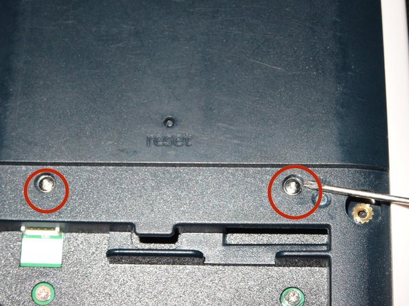 """Remove center cover """"clutch"""" screws with 1mm screwdriver."""