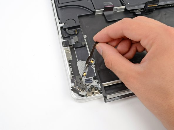 Remove the microphone assembly from the MacBook Pro.
