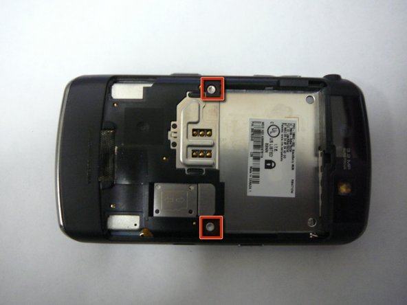 Remove the 2 screws (T6) under the battery compartment they are located as shown in red.