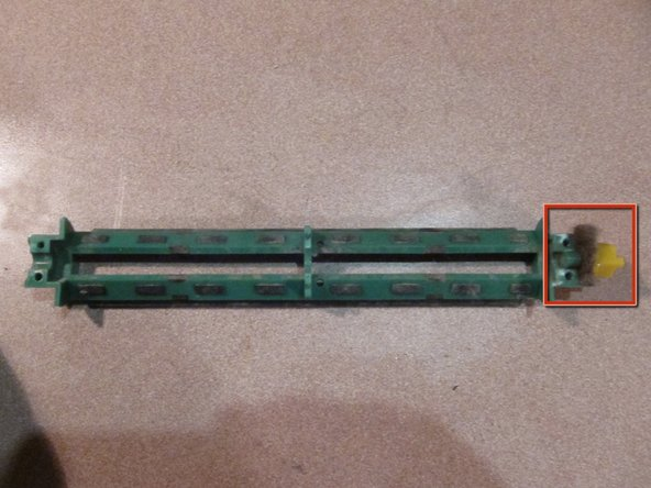 Remove yellow bearing from green bristle housing.