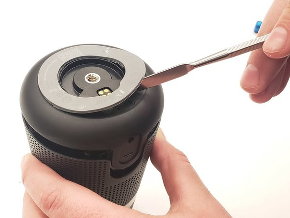 Use a plastic opening tool or metal spudger to remove the rubber mount from the bottom of the speaker.
