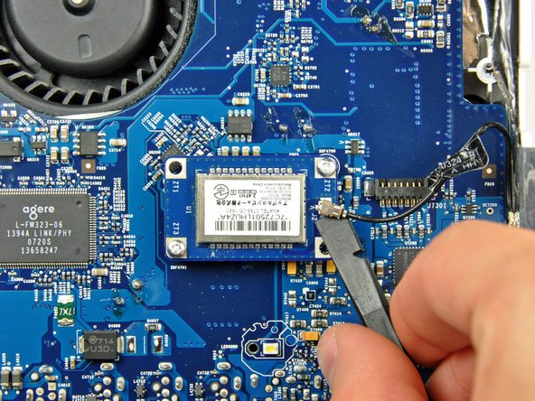 Use the flat end of a spudger to pry the Bluetooth antenna cable connector up off the Bluetooth board.