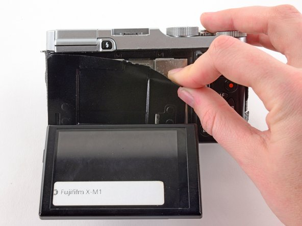 Use two fingers to peel back and remove the black plastic cover from behind the LCD.