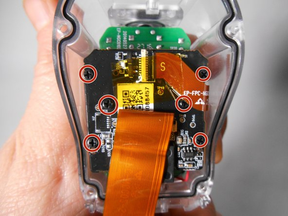 Repeat the same process as in Step 6 to  release the flat ribbon cable from the black rectangular latch