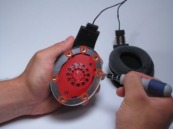 """Make sure you are working on the speaker that has the label """"R"""" for the right ear. This  speaker is the one you must disassemble in order to access the motherboard."""