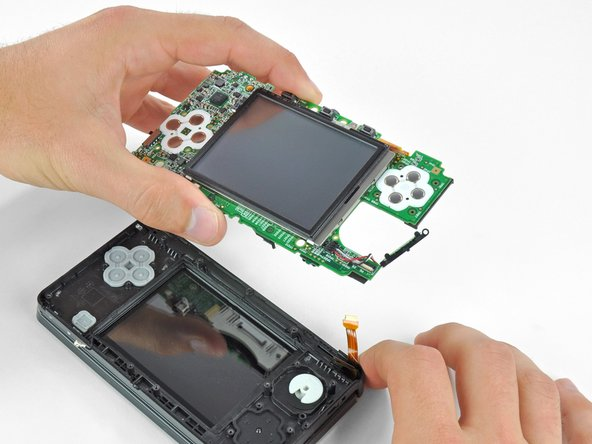 Remove the motherboard assembly from the rest of the device.