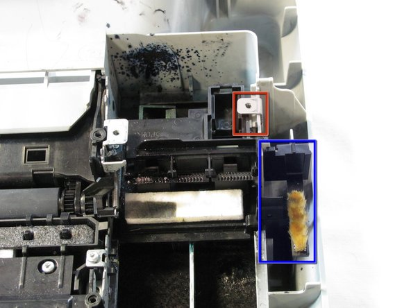 Remove the metal tab by rotating it away from the body of the printer and pulling up.