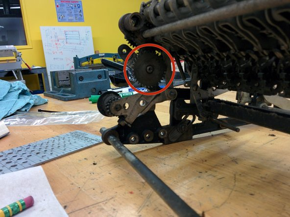 Pull the clutch assembly away from the frame, then rotate down, and pull off.