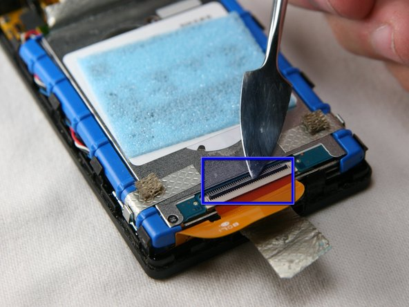 Unclick the black bar connecting the orange hard drive cable to the bottom of the hard drive. Gently push towards the bottom of the device on the black bar until you hear a click sound. It is now disengaged from the hard drive.