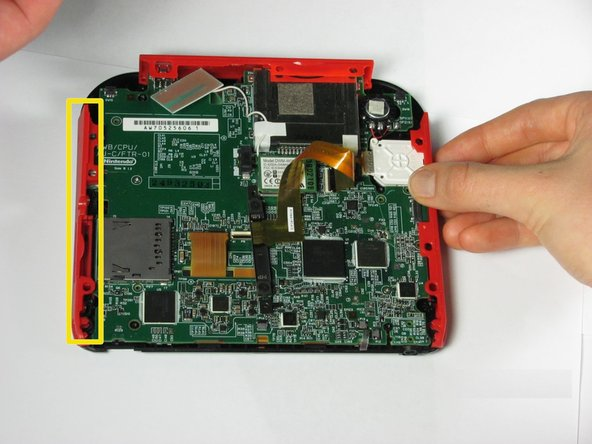 Hold the side panels of the device's case with your fingers and pull outward to remove them.