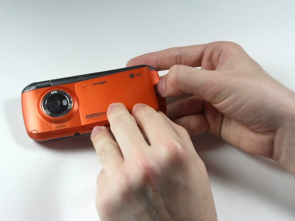 Push/pull the latch away from the camera, causing the battery to pop out.