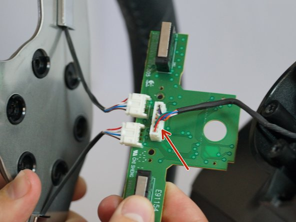 Carefully pinch and unplug the large 7-pin connector under the PCB board.