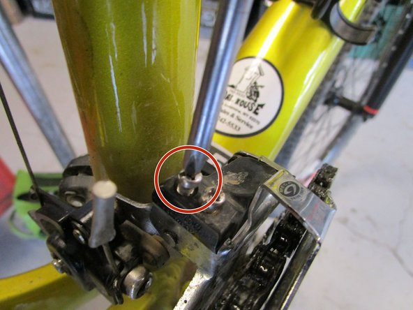 Shift to 3rd gear (the largest cog and farthest from the body of the bike)