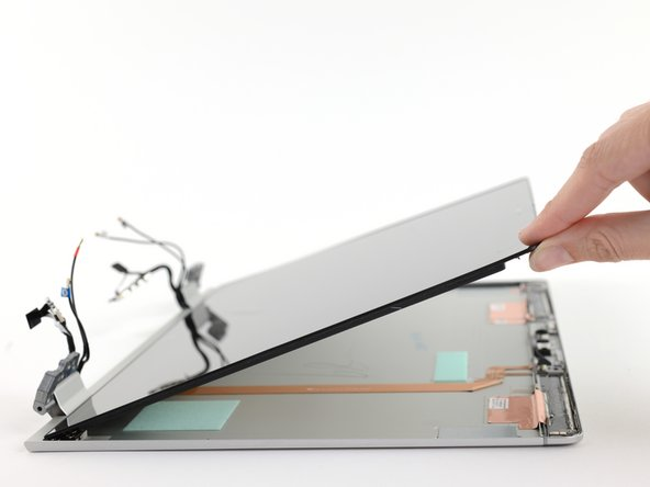 The webcam slider provides a fairly safe access point. The thin adhesive is easy to slice through, and the lack of breakable plastic clips makes removal and reassembly much easier.