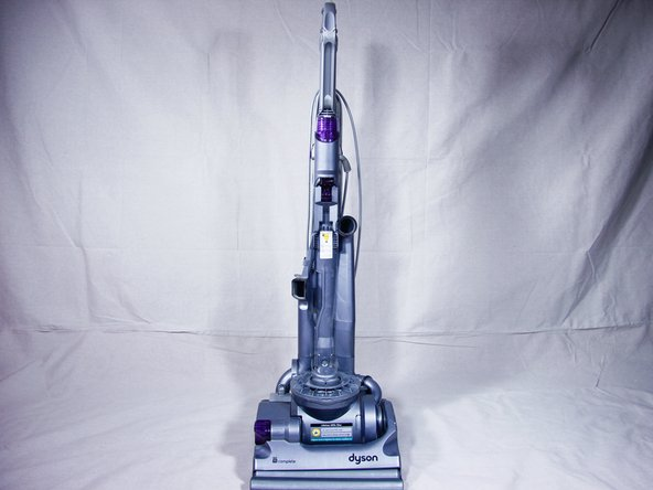 Start with your Dyson DC14 unplugged, standing upright and facing towards you.