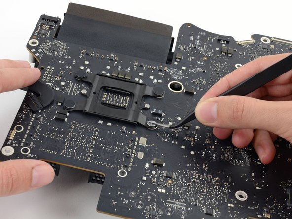 Remove four black stickers from the back of the CPU heat sink.