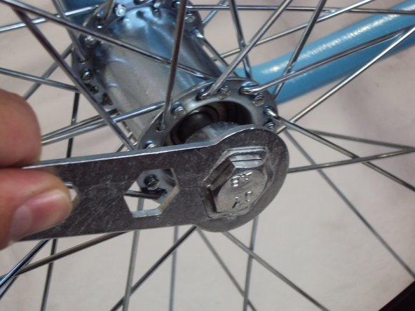 Screw the bolt on the outside of the wheel with a 19 mm socket wrench.