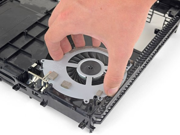 Lift the fan straight up out of the PS4 shell.