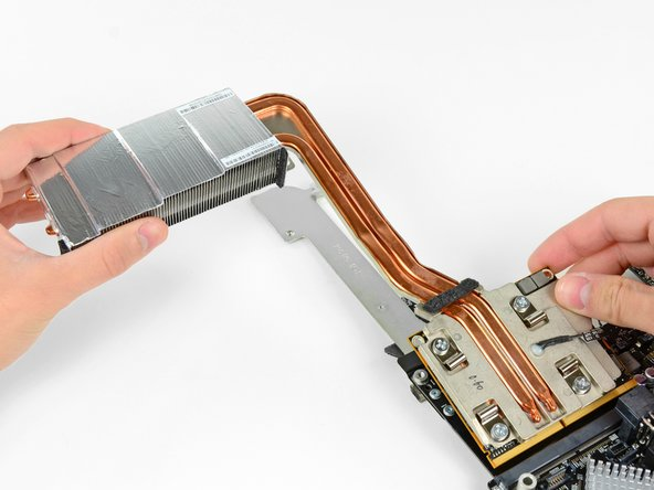 Lift the GPU heat sink slightly and pull the GPU board out of its socket on the logic board.