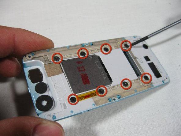 With the slider mechanism separated from the screen casing the 8 screws securing the slider mechanism are visible.